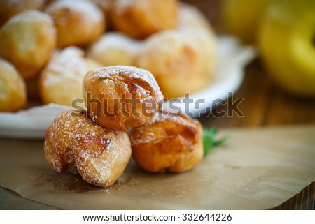 fried cottage cheese balls with slices of quince in