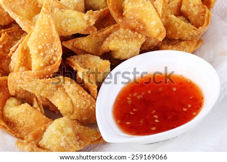 Fried dumpling and sauce on white paper - stock photo