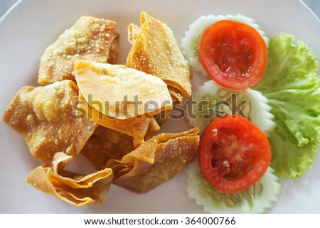 Fried dumpling with potato and salad
