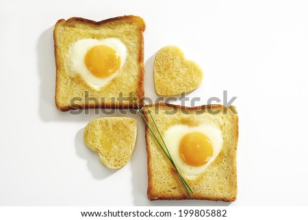 Fried egg (heart shape) in toast bread, elevated view - stock photo