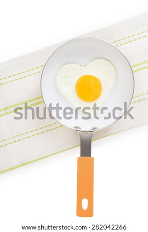 Fried egg in heart shape on pan isolated on white background, top view. Fresh modern image language. Culinary arts.  - stock photo