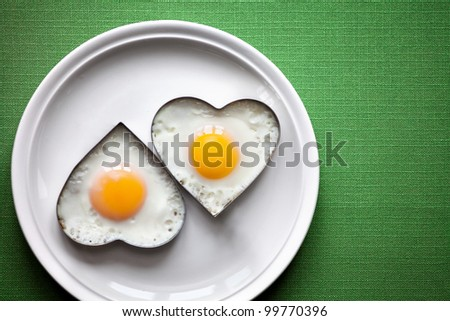 Fried egg on heart-shaped . - stock photo