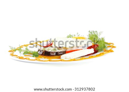 fried egg served on white plate with vegetables - stock photo