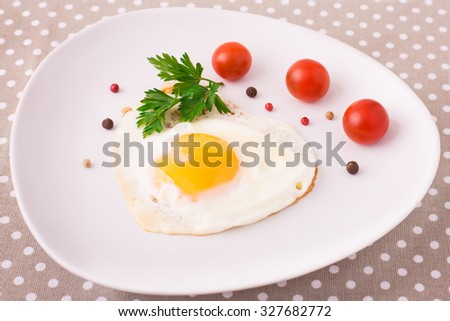 Fried egg with cherry for breakfast