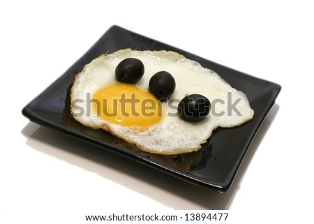 fried egg with olives on dish