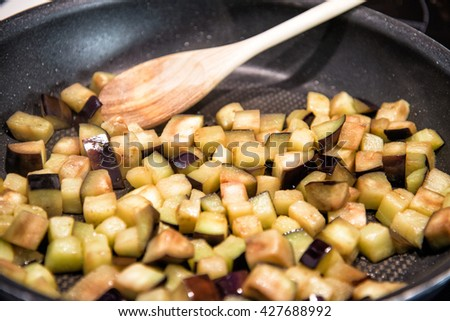 fried eggplant in the pan - stock photo
