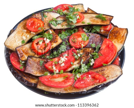 fried eggplants, red tomato and garlic on black plate isolated with white background - stock photo
