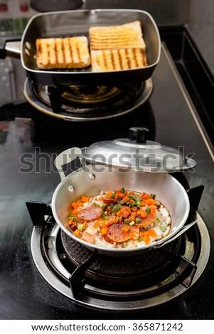 Fried eggs for breakfast  in mini pan - stock photo