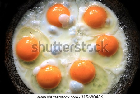 Fried eggs fried eggs from 6 eggs fried in a pan - stock photo