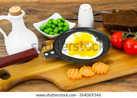 Fried Eggs in the Form of Heart Studio Photo - stock photo