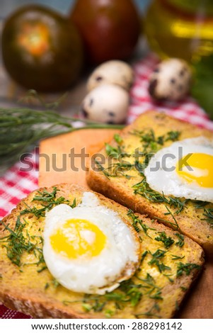 fried eggs on frying pan with bread,oil in studio - stock photo