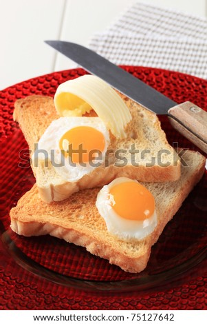 Fried eggs on slices of toasted bread