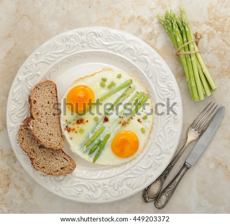 fried eggs with asparagus on a plate - healthy Breakfast. top view - stock photo