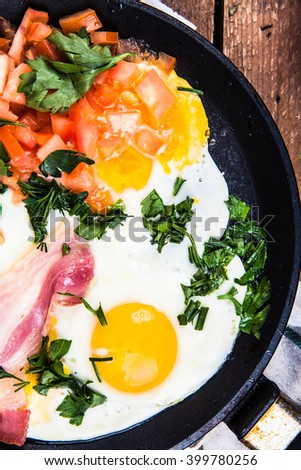 fried eggs with bacon and herbs
