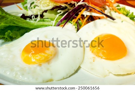 fried eggs with fresh salad - stock photo