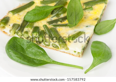 fried eggs with green beans and spinach