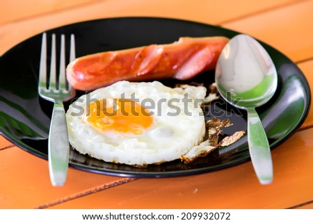 fried eggs with hot dog, breakfast for child.