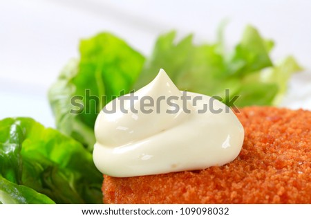 Fried ermine cheese with lettuce and mayonnaise - stock photo