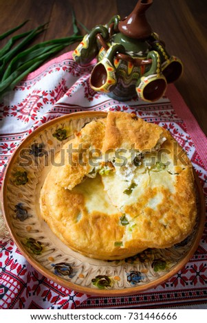 Fried feta cheese pie section on rustic background