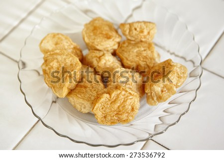 Fried fish cake ready to be served - stock photo