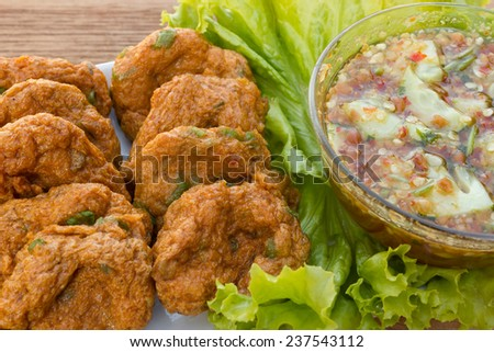 Fried fish cakes with sweet chili sauce. Thai Appetizers. Favorite food of Thailand. Local name is Tod-mun. - stock photo