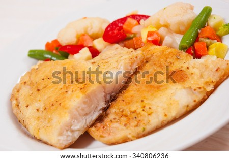 Fried fish fillet and Mixed vegetables - stock photo