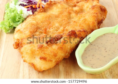 fried fish fillet with vegetables - stock photo