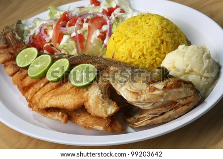 Fried Fish/ Fried Fish served with side salad, rice, and mash potatoes.