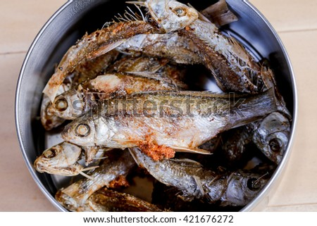 fried Fish in food carrier