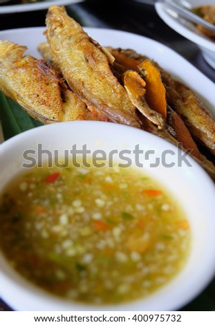 Fried Fish Mixed Turmeric and Herb - Thai Cuisine with seafood sauce.