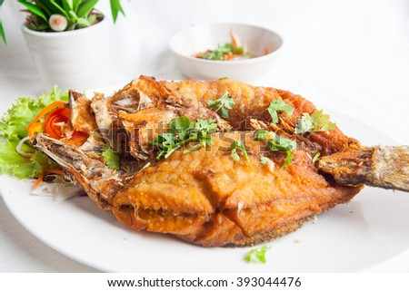 Fried fish on white background
