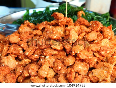 """Fried fish patty or """"Tod Mun"""" , the favorite Thai native food. - stock photo"""