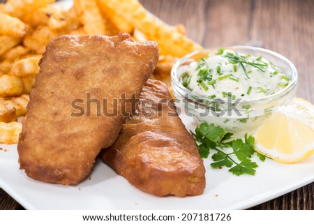 Fried Fish with french fries on a plate (close-up shot) - stock photo