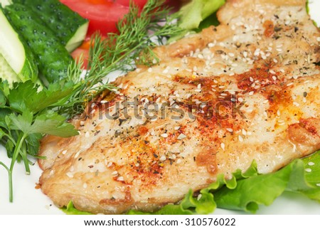 fried fish with spice and vegetables
