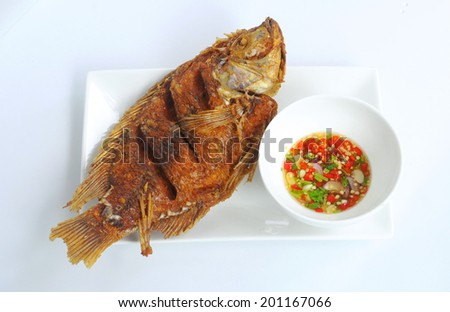 fried fish with Thai style chili fish sauce - stock photo