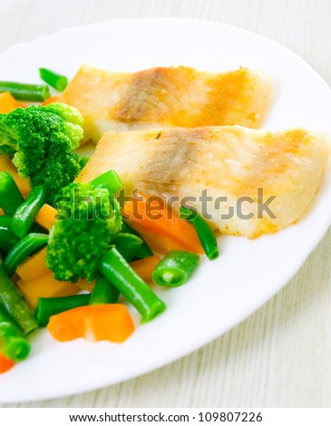 fried fish with vegetables