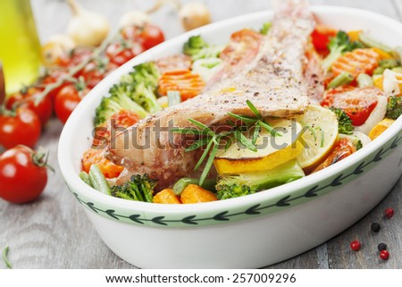 Fried fish with vegetables in the  pot