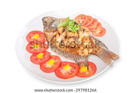 fried fish with vegetables on white background