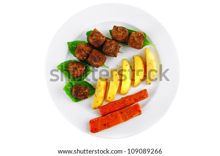 fried french cutlets with potatoes and basil