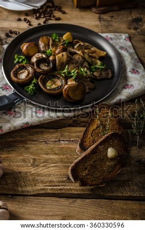 Fried fresh mushrooms with herbs, garlic toast, homemade bread