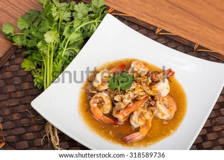 fried garlic shrimp pepper asia food wooden background - stock photo