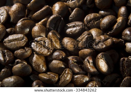 "Fried grains of coffee ""Arabica"", spot studio lights, the view from the top"