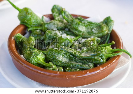 Fried green peppers Padron with olive oil and sea salt. Traditional Spanish tapas. - stock photo
