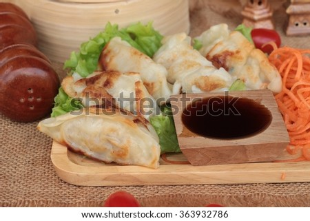 Fried gyoza and sauces - traditional Japanese food