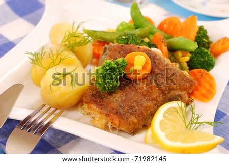 fried halibut fish with vegetables and potato for dinner - stock photo