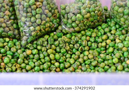 Fried holland bean, green peas - stock photo