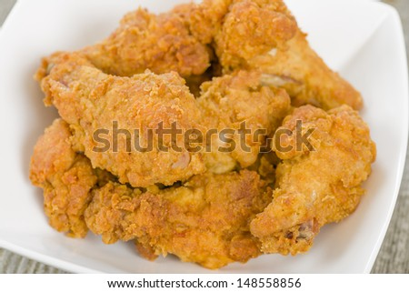 Fried Hot Chicken Wings - Chicken wings dusted in spicy flour and fried until crispy. - stock photo