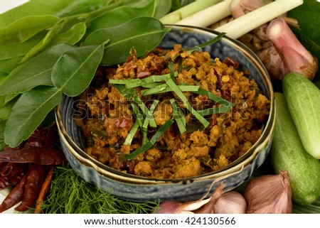 Fried hot southern chilli paste with pork: a popular dish in the south of Thailand. (Thailand garnish herbs with medicinal properties or clean food).