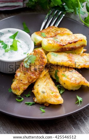 Fried in batter vegetables, zucchini tempura with dip, spring fresh dish, summer appetizer - stock photo