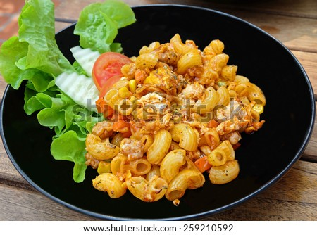 Fried macaroni with egg,chicken and vegetable in tomato sauce - stock photo